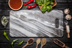 Marble board with different spices Royalty Free Stock Photos