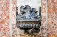 The marble bowl in the shape of a flower which is the holy water in Basilica di San Giovanni in Laterano in Rome, capital of Italy. The marble bowl in the shape royalty free stock photography