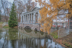 Marble bridge in the autumn Park, Saint Petersburg, Russia. Attraction of Catherine Park, on repairs Stock Photo