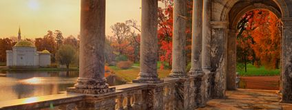 Marble bridge in Catherine garden in Pushkin. Panorama of the interior of the Marble bridge and pavilion the Turkish bath at dawn in the Catherine Park of Stock Photography