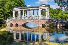 Marble bridge in the landscape part of the Catherine Park of Tsarskoye Selo Royalty Free Stock Image
