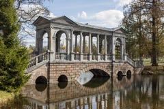 Marble bridge in park. Marble bridge in the Catherine Park, Sankt-Peterburg, Russia Royalty Free Stock Image