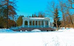 The Marble Bridge in the park of Tsarskoye Selo. The Marble Bridge near the Great Pond in the Catherine Park. The Tsarskoye Selo, St. Petersburg, Russia Royalty Free Stock Photos