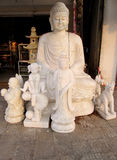 Marble Buddha sculptures on the fabric Stock Photography