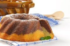 Marble bundt cake and bundt cake pan Royalty Free Stock Image