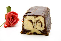 Marble cake. With chocolate and flower Royalty Free Stock Image