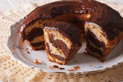 Marble cake with chocolate cut on a plate. horizontal Stock Photo