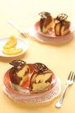 Marble Cake with chocolate glaze and caramelized orange slices Royalty Free Stock Image