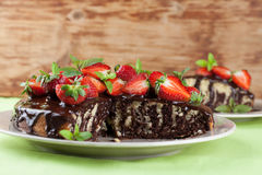 Marble cake with chocolate glaze and strawberries Royalty Free Stock Image