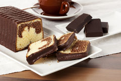 Marble cake on coffee table Stock Photography