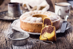 Marble cake.Easter Cake. Marble cake cup of coffee powder sugar and kitchen vintage utensil Royalty Free Stock Photography