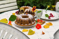 Marble cake with edible flower Stock Photography