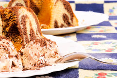Marble cake and ice cream Royalty Free Stock Images