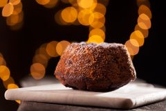 Marble cake with lights on wood Royalty Free Stock Photography