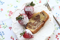 Marble cake slice with strawberries Stock Photos