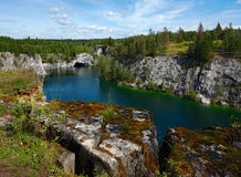 Marble canyon. The thrown marble open-cast mine in Kareliya Royalty Free Stock Photo