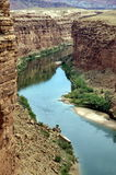 Marble Canyon. This view of the Colorado River as it flows through Marble Canyon is as seen from the Navajo Bridge in Arizona, USA. In the rear, the colorful Stock Photo