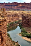 Marble Canyon. This view of the Colorado River as it flows through Marble Canyon is as seen from the Navajo Bridge in Arizona, USA. In the rear, the colorful Royalty Free Stock Photo