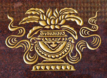 Marble carve  gold paint  in temple wall Stock Images