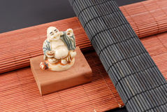 Marble Carved Buddha Sculpture. On Bamboo Mats Stock Images