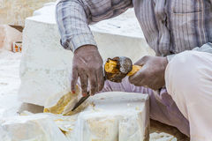 Marble carvers In Rajasthan. Rajasthan, India, 21st January 2017 - Artisans carving Hindu gods and  saints from white marble Stock Image