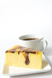 Marble cheese cake. Slice of marble cheese cake with a cup of coffee Royalty Free Stock Photography