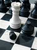 Marble chess. A chessmate position with black dead pawn Royalty Free Stock Photos