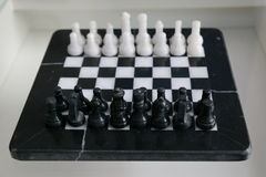 Marble chess full set. White and Black Marble chess full set starting configuration Stock Image