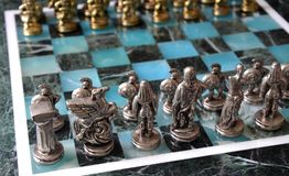 Marble chess set. With silver and gold figurines Stock Photos