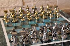 Marble chess set. With silver and gold figurines Royalty Free Stock Images