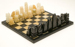 Marble Chessboard with Chessmen in Place Royalty Free Stock Photography
