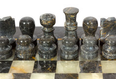 Marble Chessmen on a Chessboard Stock Images