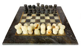 Marble Chessmen on a Chessboard Royalty Free Stock Image