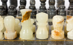 Marble Chessmen on a Chessboard Stock Photos
