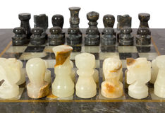 Marble Chessmen on a Chessboard Royalty Free Stock Images