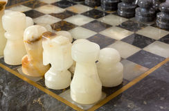 Marble Chessmen on a Chessboard Royalty Free Stock Photography