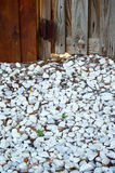 Marble chip walkway with fence Royalty Free Stock Photo
