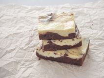 Marble chocolate brownies arranged upon parchment. Stack of freshly baked brownie cheesecake. Homemade cake as food background. Marble chocolate brownies Stock Photography