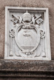 Marble coat of arms on the wall of a building Royalty Free Stock Photo