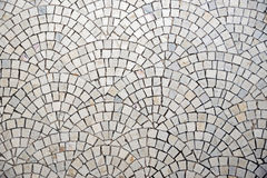 Marble cobblestone pavement with curvature Royalty Free Stock Photo