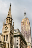 Marble Collegiate Church and Empire State Building in New York City, USA. Marble Collegiate Church and Empire State Building in New York City, United States Royalty Free Stock Image