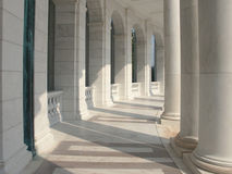 Marble Columns. A curved row of pillars joined with an elegantly carved baluster stock photo