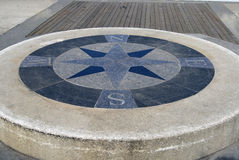 Marble and Concrete Compass Stock Photo
