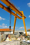 Marble crane industry. Big industrial crane at marble stone warehouse stock images