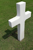 Marble Cross. A white marble cross in a military cemetery Royalty Free Stock Photo