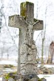 Marble cross on tomb at winter Stock Photos