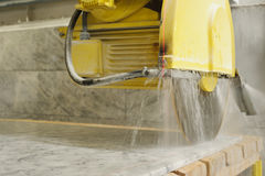 Marble cutting Stock Images