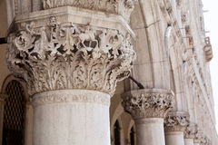Marble decor and columns, St. Mark's Square ,Venice, Italy. Marble decor, inlay and marble columns, stone carving on the facade of the cathedral of San Marco, St Stock Photos