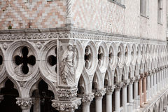 Marble decor and columns, St. Mark's Square ,Venice, Italy. Marble decor, inlay and marble columns, stone carving on the facade of the cathedral of San Marco, St Royalty Free Stock Photos
