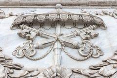 The marble decor element of the basilica of San Giovanni papal. Symbol Basilica di San Giovanni in Laterano Rome, Italy stock photo